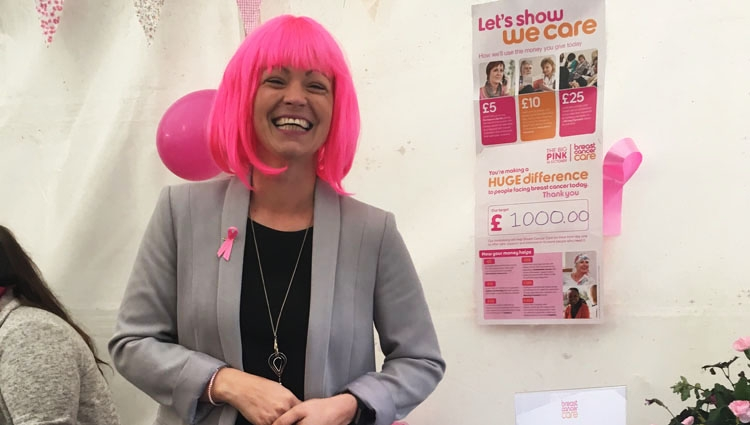 Hazel stood in front of a Big Pink poster showing that she raise £1000