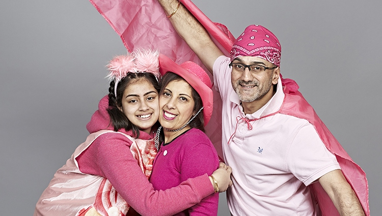 A family wearing pink outfits