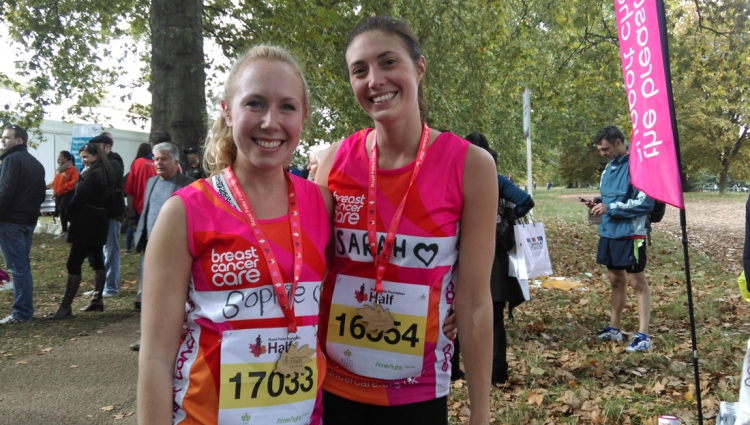 Two runners pose having finished running the Royal Parks Half Marathon supporting Breast Cancer Care