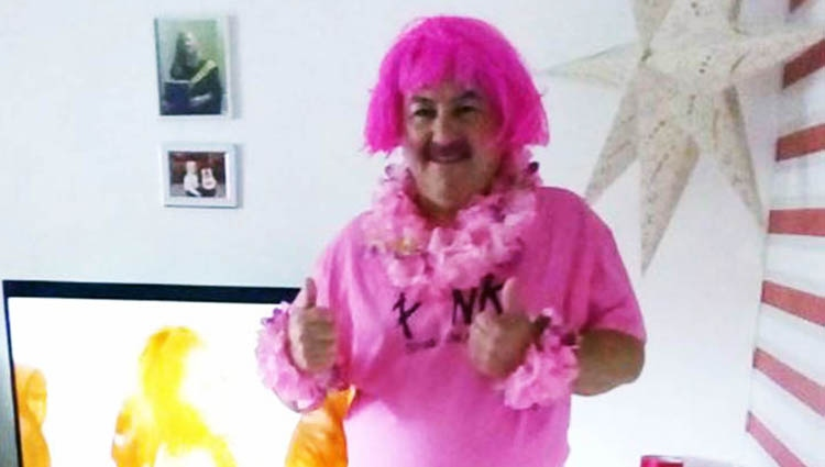 Person dressed up in pink clothes and a pink wig