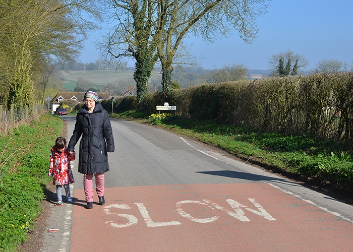 Ann walking down road