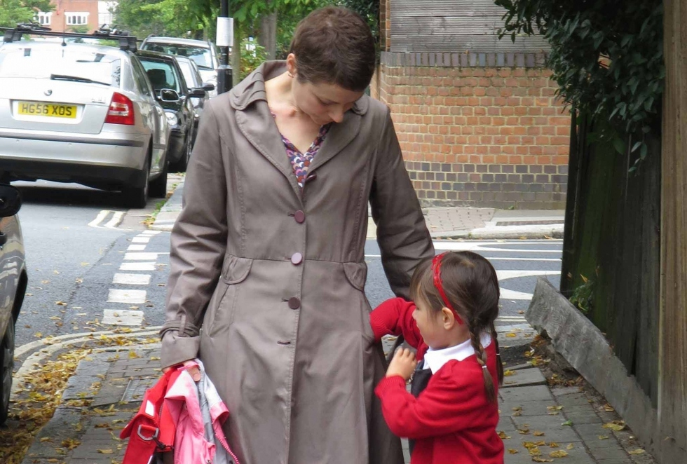 Ann and her daughter by school