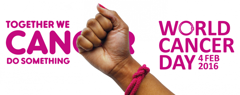 A hand wearing a World Cancer Day Unity Band