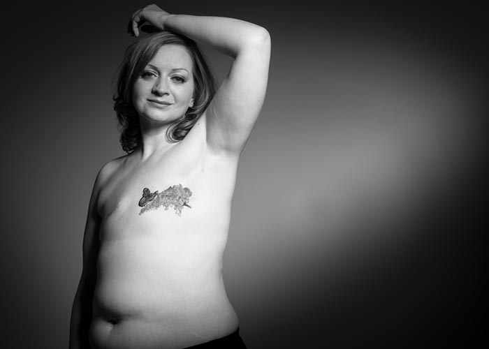 A woman with a tattoo over her mastectomy scar
