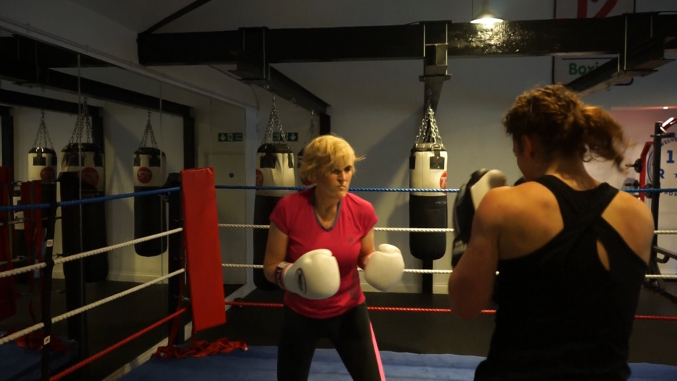 Catherine training in the boxing ring