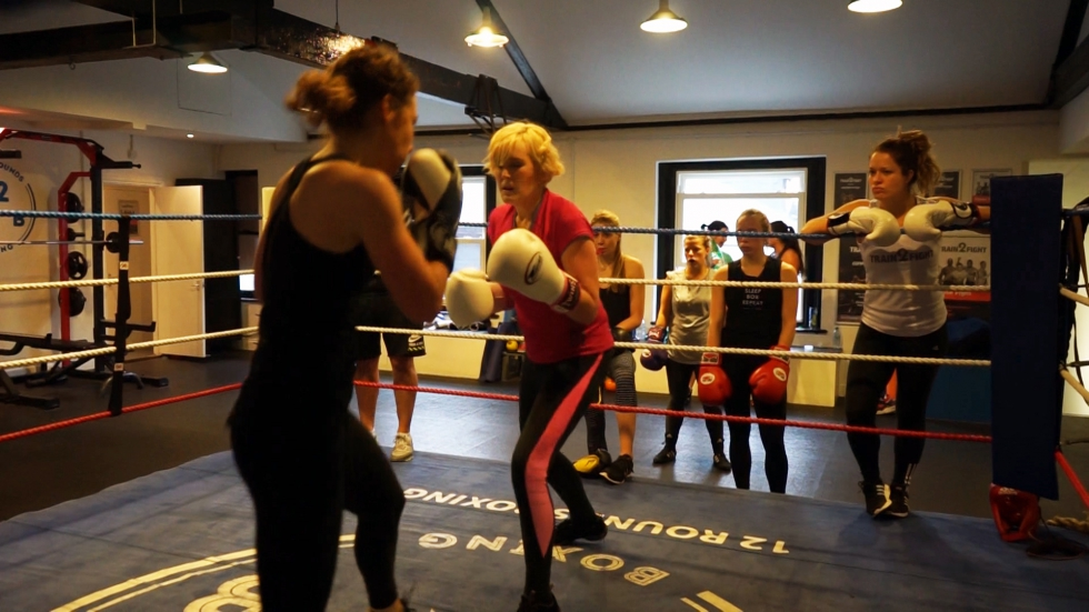 Catherine boxing with the group supporting her