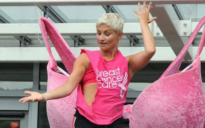 Cathie leading an exercise class in a Breast Cancer Care t-shirt