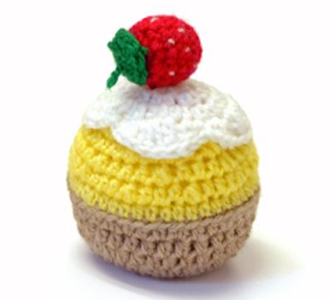 An image of a crochet strawberry cupcake