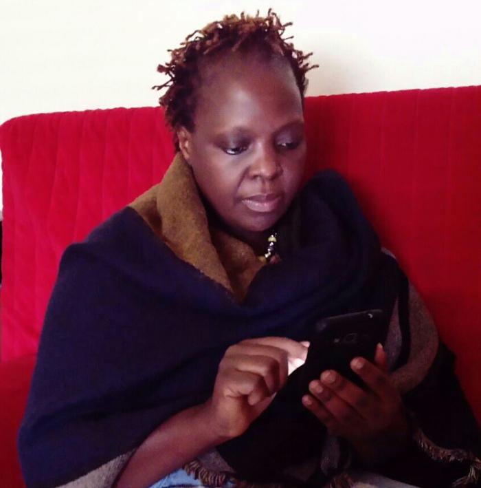 Damalie using BECCA on her phone