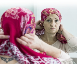 Woman trying on headscarf in mirror