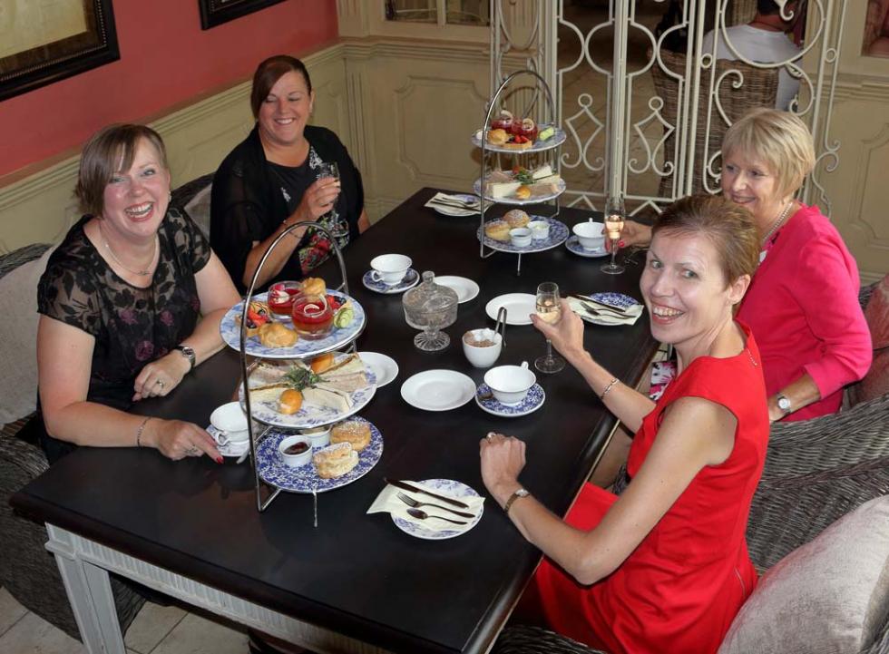 Friends having afternoon tea