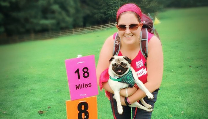 Joanna holding her pug at a Pink Ribbonwalk