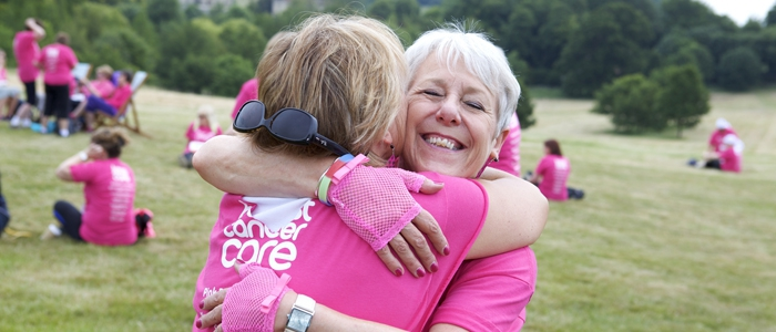 women hugging after a pink ribbonwalk