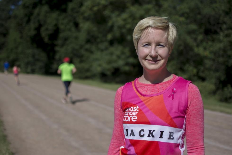 Jackie wearing the pink ribbon