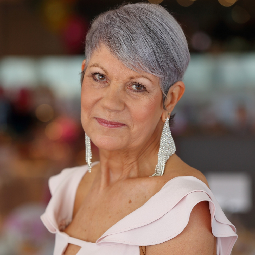 Sheila McNicol after her hair grew back, with a pixie cut style