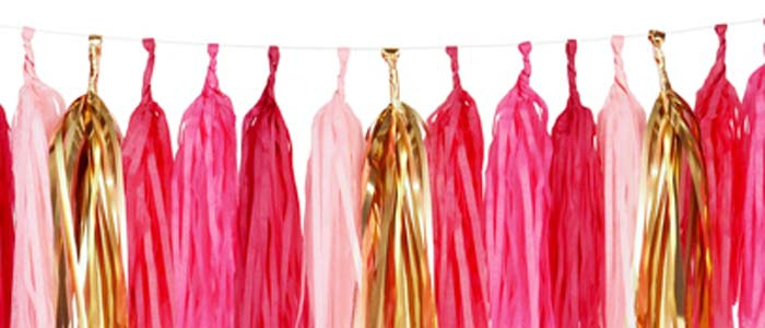 An image pink and gold party tassles