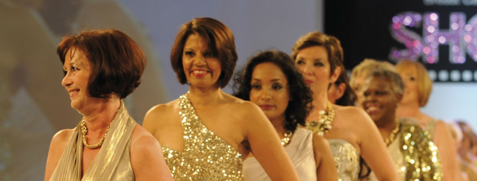 Women in gold dresses on the catwalk