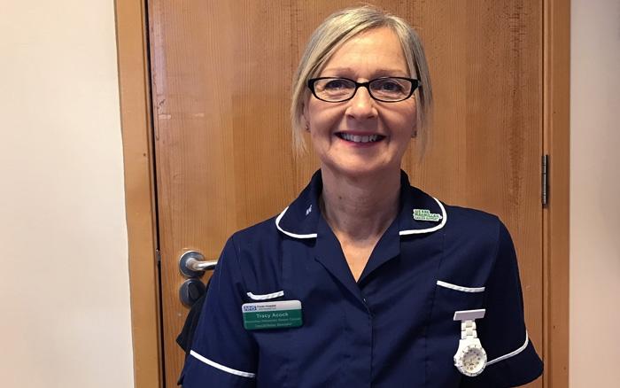 Tracy in her nurses uniform