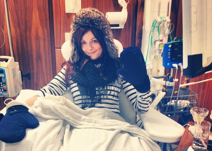 Laura wearing ice gloves in hospital