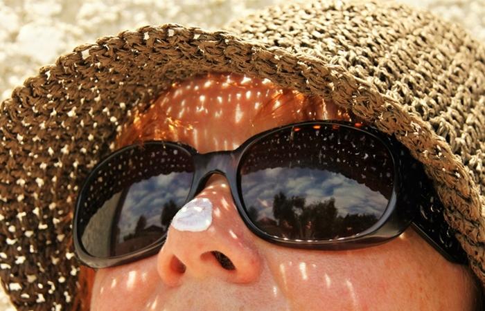 A woman wearing sun screen
