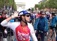 Woman cycling in Paris for Breast Cancer Care