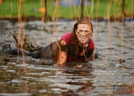 A woman taking part in Tough Mudder