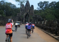 A Breast Cancer Care cyclist rides into Angkor Wat in Cambodia