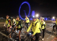 Cyclists at night on Waterloo Bridge taking part in Nightrider for Breast Cancer Care