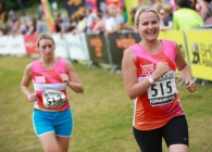 Fundraisers running in Breast Cancer Care vests