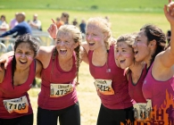 A group of female tough mudder contestants cheering
