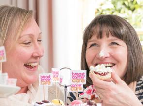 Two women eating cake