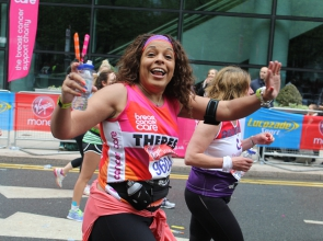 Woman in Breast Cancer Care t-shirt running the London Marathon