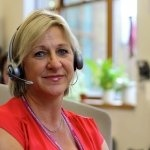 A helpline nurse with a headset on
