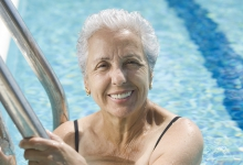 Older woman swimming