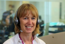 A nurse on the helpline pictured wearing a headset