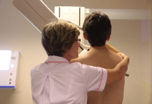 Woman having her breasts screened